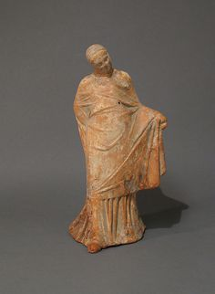 Terracotta statuette of a veiled dancer
