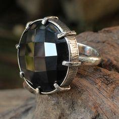 Sirilak Samanasak ~ Stunning sterling silver ring with faceted black onyx gemstone set in silver bezel and prongs. http://sirilaksamanasak.com