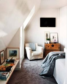 I have a bedroom with ceilings like this - I love the short shelf that runs along that otherwise unusable space. Fun Ideas To Make The Most Of Small Spaces