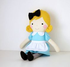✿ Alices Adventures in Wonderland is a famous story written by Lewis Carroll. It tells of a girl named Alice falling through a rabbit hole into a fantasy world where she meets the most peculiar creatures! ✿  - This doll is made with good quality cotton fabris, wool blend felt and stuffed with fiberfill. - Her face is hand embroidered. - Alices skirt is removable and the bow is sewn to the dolls hair. - She makes a great gift for little girls and a wonderful doll to decorate a nursery or kids…