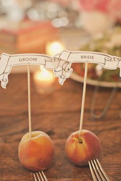 I really like this idea of using fruit as the escort card holder, it would be quite inexpensive too, and I think peaches are in season in August?