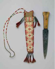 Knife and Sheath, ca. 1840, Northeast, Ojibwa, Sheath: tanned hide, porcupine quills, seed beads, tin cones, red-dyed horsehair, Knife: steel, bone, copper