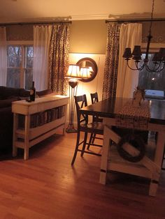 love the dining room table, and LOVE the little table/shelf behind the couch- perfect place to keep family photo albums
