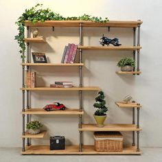 Industrial Wood and Metal Style Bookcase This unique design can be customized to fit your space. Wood variations are available. The selection is only limited by imagination.