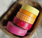 Happy Tape!  Japanese washi paper tape.  Easy to use, fun to layer.  Great for wrapping gifts and making cards.