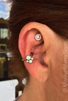 Paula switches up her conch jewelry pretty often. Today she picked out this copper titanium and opal captive cluster ring from Anatometal.