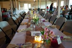 Barbecue wedding at Smokey Glen Farm: Floral burlap table runner with small bud vases filled with alstromeria, fern, baby's breath, and ranunculus. Mercury glass tea lanterns, tea votives, and real branch votives are scattered along the tables. Tan bandanna napkins tied with lavender, plum, ivory, or peach ribbons are at each place setting, along with guest favor mason jar mugs. Place Settings, Table Settings, Barbecue Wedding, Mason Jar Mugs, Burlap Table Runners, Baby's Breath, Ranunculus, Mercury Glass, Bud Vases