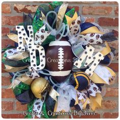 House divided wreath! Notre Dame & Michigan football wreath. More wreaths can be found on my Facebook page: www.facebook.com/CraftsandCreationsByTerri or go to my Etsy page https://www.etsy.com/shop/CreatedByTerri