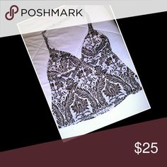 Victoria's Secret Tankini Pretty lined brown and white Tankini. No snags or fading. Wore once. See my closet for 2 matching bottoms and a coverup! Victoria's Secret Swim Bikinis
