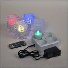 Set of 4 White Frosted/Clear crisscross cut glass candle holders and Set of 4 remote control RGB LED rechargeable tea lights with induction charging base Party Lights, Tea Lights, Led Candles, Glass Candle Holders, Cut Glass, String Lights, Lava Lamp, Criss Cross, Frost
