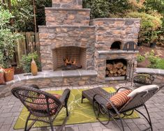 Love the custom fireplace with the pizza oven and firewood storage area. By Paradise Restored Landscaping & Exterior Design