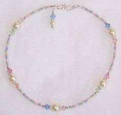 """Sugar Cookie"" handmade beaded anklet.....Swarovski ""cream"" crystal pearls, Swarovski ""lt.sapphire, silk, peach, lt.rose, crysocholla"" crystals, pastel mix glass seed beads, sterling silver Bali spacers, sterling silver beads and findings, and a sterling silver ""S"" clasp."