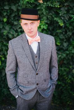 tweed groom look with peach bow tie and hat #groom #groomlook #weddingchicks http://www.weddingchicks.com/2014/03/26/rustic-romance-wedding/