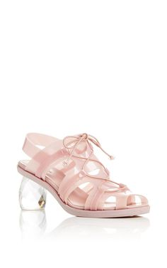 This **Simone Rocha** sandal features a jelly construction with a criss cross straps, a slingback style, and a faceted block heel.