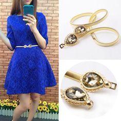 Image from http://g02.a.alicdn.com/kf/HTB1RRuMIpXXXXawXFXXq6xXFXXXS/2015-New-Fashion-Designer-Belts-For-Women-Gold-Metal-Belt-Rhinestones-Clasp-Front-Stretch-Spring-Waist.jpg_350x350.jpg.