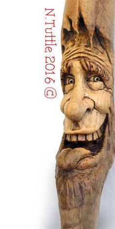 """Twiggy"" 3 inches tall and about a half an inch across his cheekbones and a depth of one whole inch. Signed and dated: N. Dremel Carving, Wood Carving Art, Wood Art, Cedar Posts, Celtic Art, Recycled Wood, Woodcarving, Wood Sculpture, Canes"