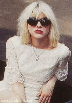 F'n love this pic of her. Everything from the glasses to her dress, which i think she wore for the cover of Pretty On The Inside.