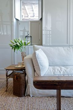 *white sofa; worn bench