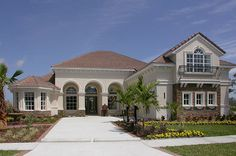 Three elegant arches form a dramatic entry to this stunning newly built home in the Grand Hampton community from ICI Homes in Tampa, Florida.