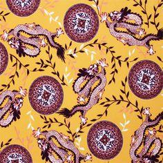PUL poly imprimé Dragon orange laize 140cm (par 10cm)