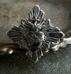 Silver pen symbolizing the Sacred Heart of Jesus