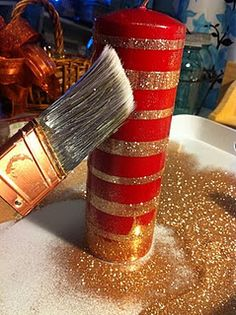 Glitter candles with double sided tape. What a cute idea that could take a $4 candle and make it look like it's worth four times as much! I'd probably do blue candle with silver or vice versa to match my decorations