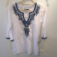 Tunic Sulu embroidered tunic top stunning on !!worn by celebrities pair it up with a bathing suit or a pair of skinny jeans. Sulu Tops Tunics