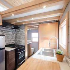 The Blue Heron's kitchen includes a four-burner propane range cooker. I like the small kitchen. I  would add open shelves, knife bar around the stove area, small pantry would be handy