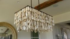 an oyster shell chandelier in the dining area