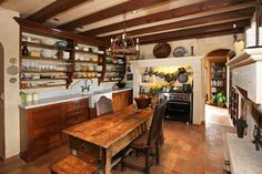 Open wall shelves - imagine painted yellow Kitchens - mediterranean - kitchen - orange county - V.I.Photography & Design