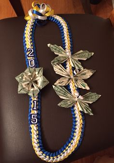 Royal blue, gold and white double braided ribbon lei Graduation Crafts, Graduation Leis, Money Lei, Money Origami, Royal Blue And Gold, Blue Gold, Ribbon Lei, Ribbon Braids, Money Necklace