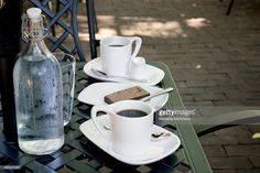 Stock Photo : Coffee, Brownie and Bottle of Water on Patio Table at Cafe, Dundas, Ontario, Canada