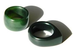 Jade Womens rings by Aaron Brown - A Carved Piece.  The green wedding ring is made out of marbled NZ Jade. The black ring is made out of fine black Australian Jade. #jade #ring  #Pounamu #womens