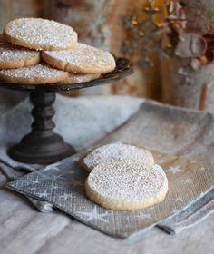 EGGNOG BUTTER COOKIES  1 3/4 sticks unsalted butter, at room temp  3/4 cup sugar  1/4 t salt  1 1/2 t vanilla extract  2 t dark rum  2 t brandy  1/4 t freshly grated nutmeg  1 large egg yolk  2 cups all-purpose flour  powdered sugar