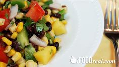 Clean Mango Black Bean Salad - Rich in protein, complex carbs, healthy fats and fiber. No oil dressing. Only 150 calories and 4 WW points  per 1.5 cup serving.