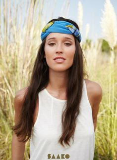 This bold headband from Saako Design looks great over dark hair.  Simple and chic.