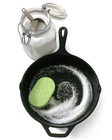 Clean your cast iron skillet with salt. I don't use this much salt but it works amazing and preserves the pan's seasoning.