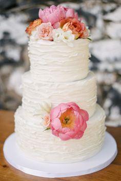 A ruffled wedding cake with pretty blooms: http://www.stylemepretty.com/california-weddings/st-helena/2015/01/02/rustic-summer-wedding-at-annadel-estate-winery/ | Photography: Melanie Duerkopp - http://melanieduerkopp.com/