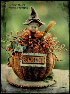 small glittered pumpkin with figurine and bittersweet`