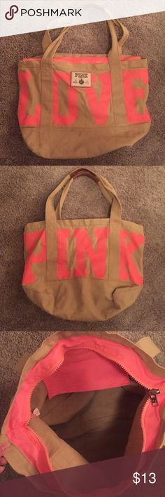 VS Pink Tote Bag. I love this bag, but trying to consolidate! Hot coral and tan. Leather style handles in a light camel color. A couple of marks from use but would likely wash out. No rips or tears! One zippered pocket on the inside. Victoria's Secret Bags Totes