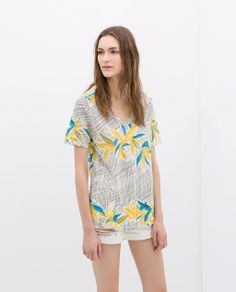 Image 1 of PRINTED V-NECK T-SHIRT from Zara