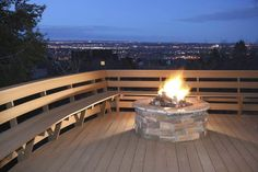 Even on a wooden deck in the middle of an urban environment, it's possible to have a fire pit.