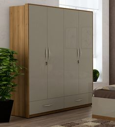 Buy Nicole 4 Door Wardrobe in Natural Teak Finish by CasaCraft Online - 4 Door Wardrobes - Wardrobes - Furniture - Pepperfry Product 4 Door Wardrobe, Wardrobe Design Bedroom, Wardrobe Furniture, Closet Bedroom, Wooden Storage Boxes, Tall Cabinet Storage, Storage Ideas, Solid Wood Furniture, Upholstered Furniture