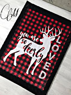 So cute plaid buck with black swirl minky. All minky on both sides. Blanket measures approximately 28x38 inches. Perfect for swaddling, car seats, strollers, etc