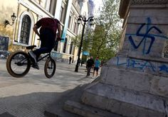 What appears to be a swastika spray-painted on a wall of the University of Chile in downtown Santiago [File] Photo By: REUTERS