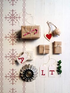 Christmas/ Gift wrapping ideas. Cross-stitched gift tags. via Little Helsinki