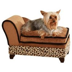 Microfiber pet bed with toy storage.  Product: Pet bedConstruction Material: Polyester, polyurethane, CA foam, wood and boardColor: LeopardFeatures: Storage underneath cushion for toys and bonesDimensions: 14 H x 21.75 W x 13 DNote: Designed to be used with the specialized memory foam inserts in the 3 Piece Comfort Pet Bed Set