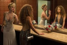 Rosalyn Rosenfeld (Jennifer Lawrence) & Sydney Prosser (Amy Adams) in the Grand Old AC Hotel powder room in Columbia Pictures' AMERICAN HUSTLE.  (Jennifer Lawrence dress: made for film, jewelry, shoes: vintage / Amy Adams dress: made for film, jewelry, shoes: vintage) Photo by:  Francois Duhamel