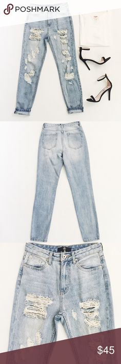 """Missguided Riot High Rise Mom Jeans Missguided Riot High Rise Mom Jeans in a light wash featuring factory distressing.  Wear with heels or fresh sneakers!  Slightly tapered leg.  Pre-loved but in excellent condition.  Small smudge on front leg, see pic.  May be treated and further cleaned.  No other damage or signs of wear.  Last 2 pics stock photos, used to show fit.  Measurements laying flat: Waist (across): 13.5"""" Hips: 17.25"""" Inseam: 28.5"""" Rise: 11"""" Missguided Jeans"""