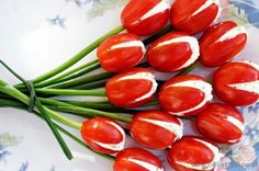 Stuffed Tomato Tulips .. Recipe is in Polish but here's what they used.:   13 large cherry or small Roma tomatoes  14 stalks of green onions or chives for the stems  200g farmers cheese or cottage cheese for filling (or you could use goat cheese, egg or chicken salad)  1 cucumber  1/2 teaspoon dried basil  Salt and pepper